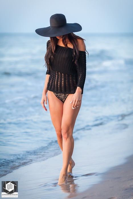 beautiful woman walking along the beach, lifestyle fashion shoot for golden lizard clothing