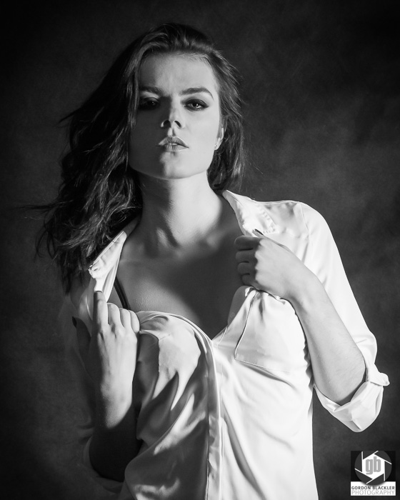 moody black & white photo of a beautiful brunette in a white shirt